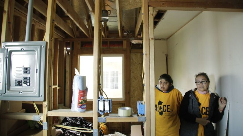 Mariela Reyes, right, hired Eco Solar Home Improvement but has incomplete work.