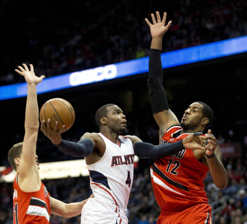 Atlanta;s Paul Millsap goes up for a basket against Portland's LaMarcus Aldridge during the first half of a game Jan. 30.