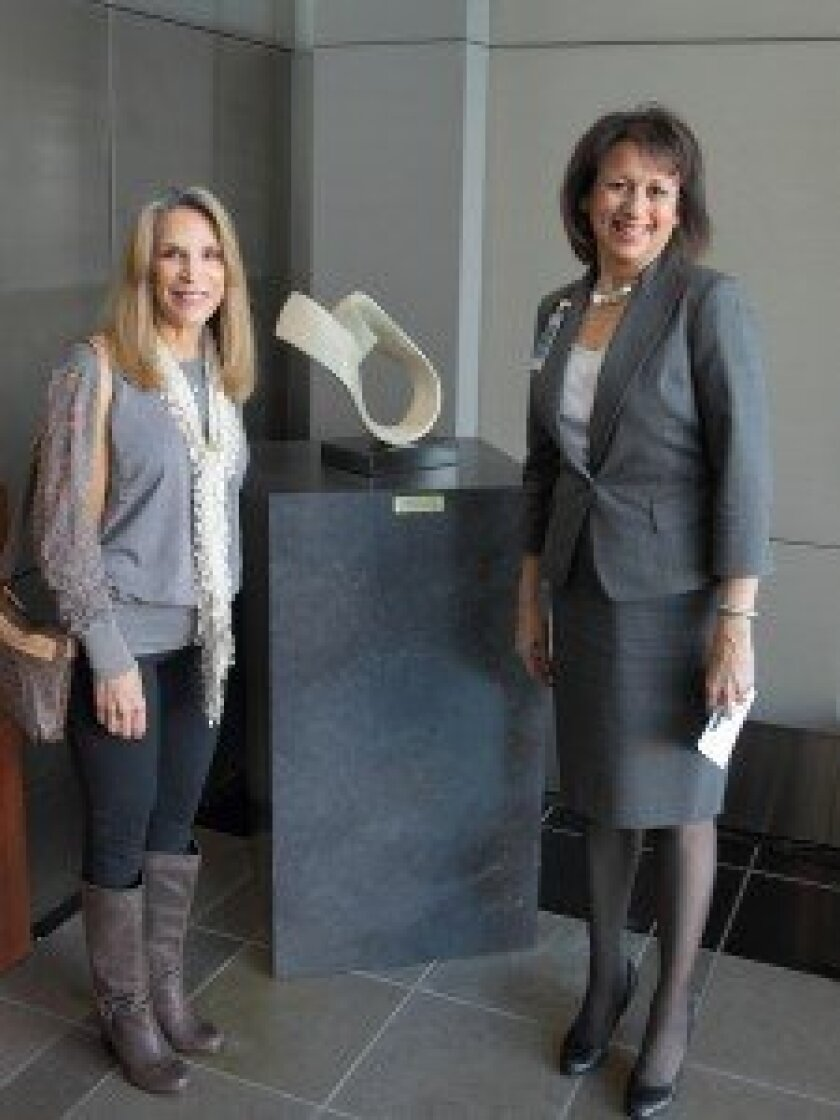 Sculptor Maidy Morhous with Elana Cresap (Senior Director, Clinic Operations Scripps Clinic). Photo/Jon Clark