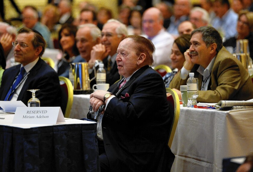Republican donor Sheldon Adelson listens to New Jersey Gov. Chris Christie speak during the Republican Jewish Coalition conference in Las Vegas.