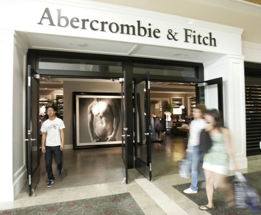 FILE- In this Aug. 12, 2008 file photo, shoppers walk in front of an Abercrombie & Fitch store in San Jose, Calif. Abercrombie & Fitch is one of many teen retailers struggling financially. It is closing its Westfield UTC store next month as it pares down locations nationwide.