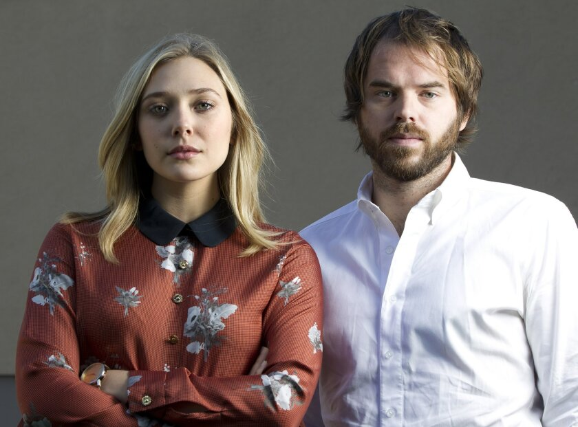 "Elizabeth Olsen and Sean Durkin make their big-screen and directorial debuts, respectively, in ""Martha Marcy May Marlene."" Earnie Grafton • U-T"