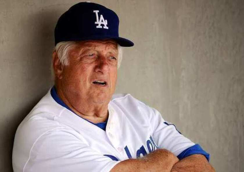 """Hall of Fame manager Tommy Lasorda suffered a """"mild heart attack"""" Monday."""