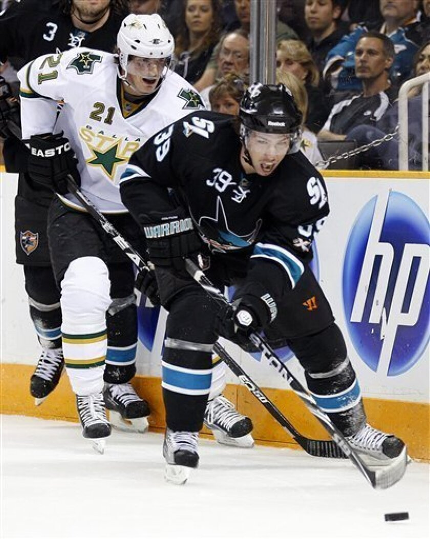 San Jose Sharks' Logan Couture (39) leads Dallas Stars' Loui Eriksson to the puck during the first period of an NHL hockey game Thursday, March 31, 2011, in San Jose, Calif. (AP Photo/Ben Margot)