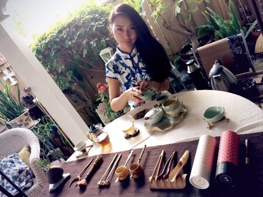 Sophia Wang sets up a traditional tea ceremony, similar to what would be held at La Jolla Riford Library.