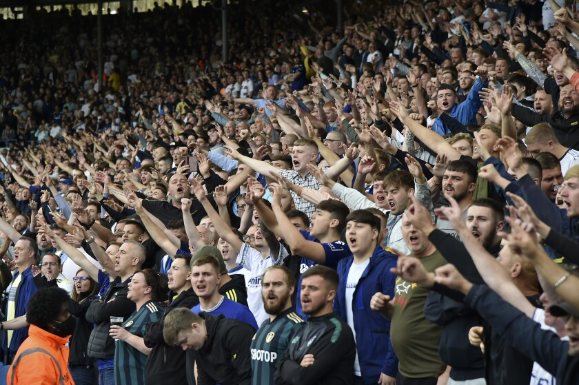 Leeds fans cheer during the English Premier League soccer match between Leeds United and Liverpool at Elland Road, Leeds, England, Sunday, Sept. 12, 2021. (AP Photo/Rui Vieira)