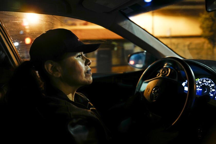 Sylvia Vigil drives down International Boulevard in Oakland, looking to help women she thinks are prostitutes.