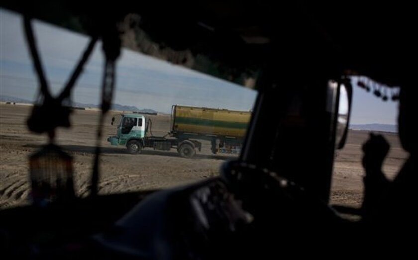 In this Feb. 9, 2011 picture, Pakistani fuel truck drivers head from Spinboldak, Afghanistan towards Kandahar, Afghanistan with fuel for NATO troops. The war, now in its 10th year, consumes roughly 1.5 million gallons, about 100 truckloads, of fuel a day, according to NATO forces.