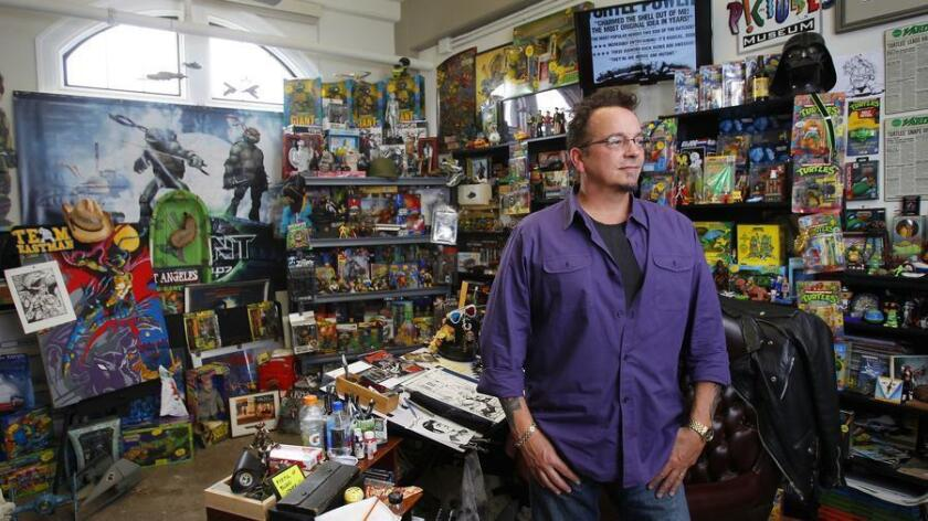 Kevin Eastman is the co-founder, and still works on, the Teenage Mutiant Ninja Turtles cartoon, is shown here in a replica work space that contains thousand of personal items at the San Diego Comic Art Gallery in NTC. (UT San Diego/Zuma Press)