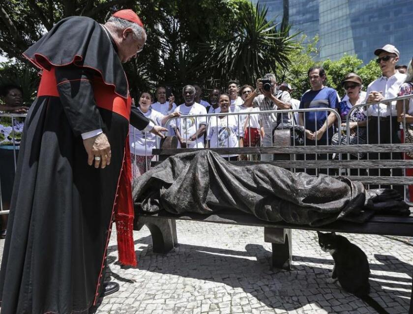 "Rio de Janeiro Archbishop Joao Orani Tempesta blesses the sculpture ""Homeless Jesus,"" following its unveiling on Sunday, Nov. 18, in front of Rio's Metropolitan Cathedral. EFE-EPA/Antonio Lacerda"