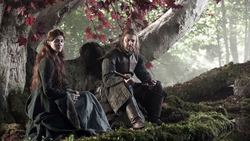 """This photo of released by HBO shows Sean Bean, right, portraying Eddard Stark in """"Game of Thrones."""""""