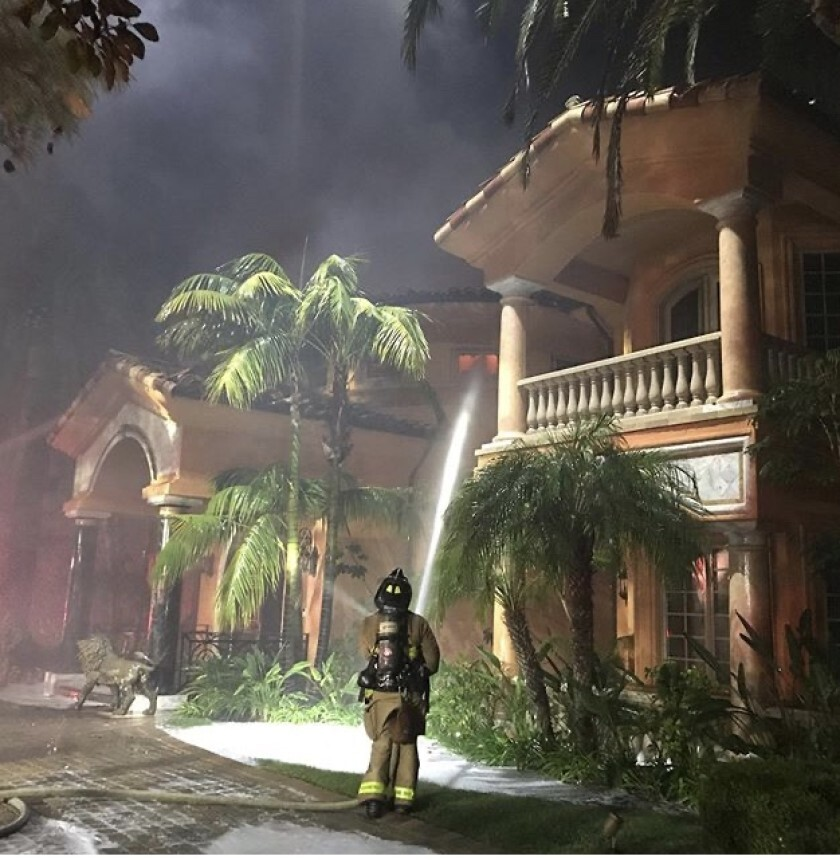 A $10.8 million Rancho Santa Fe mansion was destroyed in a two-alarm fire that ignited Sunday night. The cause is under investigation