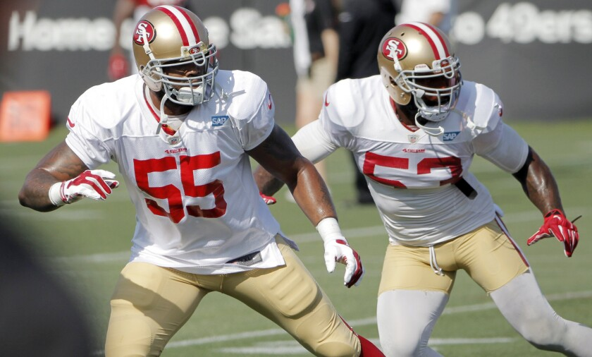 San Francisco 49ers outside linebacker Ahmad Brooks, left, and NaVorro Bowman line up during a training camp practice on Aug. 18.