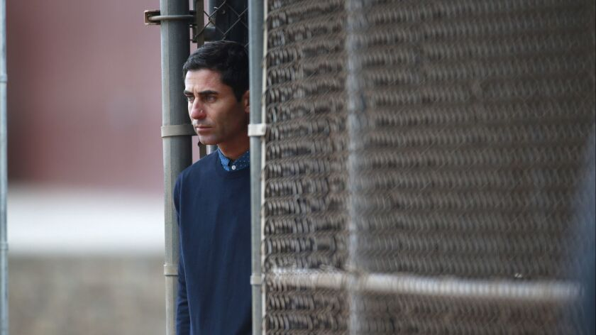 Padres General Manager A.J. Preller looks on during a spring training workout.