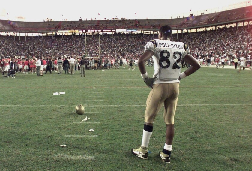 UCLA's Brian Poli–Dixon is dejected as he watches Miami celebrate on the field at the Orange Bowl on Dec. 5, 1998.