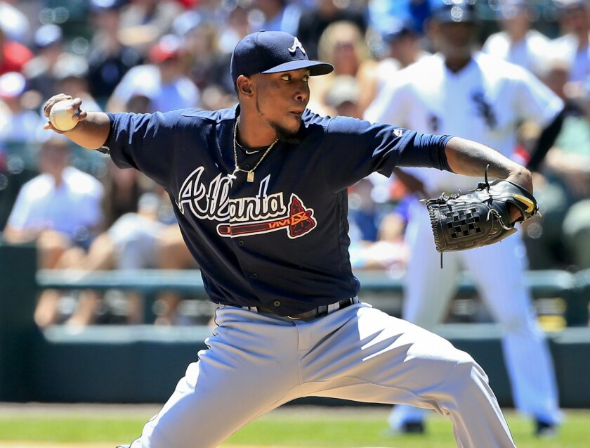 Atlanta Braves starter Julio Teheran delivers a pitch during the first inning of a baseball game against the Chicago White Sox, Saturday, July 9, 2016, in Chicago. (AP Photo/Kamil Krzaczynski)