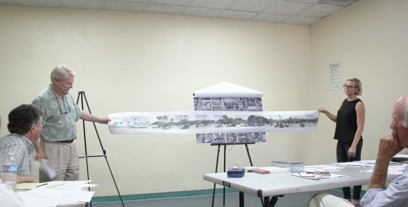 During the Aug. 18 DPR meeting, architect Jim Alcorn (with Kaysie Rozsonits) shows how a mixed-use project proposed for the corner of Eads Avenue and Pearl Street would fit in with homes to the east along Eads Avenue. The two-story mix of retail and residential space, designed by Alcorn & Benton Ar
