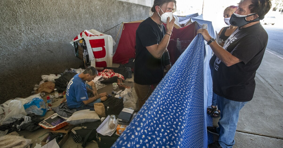 Chaos, confusion as judge pushes plan to clear homeless camps from near freeways