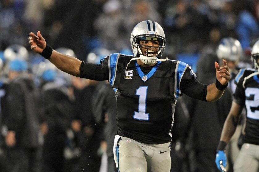 Carolina Panthers' Cam Newton (1) celebrates a Panthers touchdown against the Indianapolis Colts in the second half of an NFL football game in Charlotte, N.C., Monday, Nov. 2, 2015. (AP Photo/Mike McCarn)