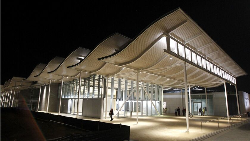 The new city hall lights up the darkness in Newport Beach at its new location on Avocado and Farallo