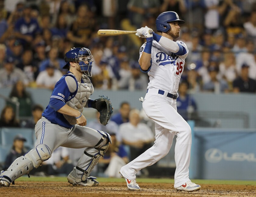 Dodgers first baseman Cody Bellinger hits a three-run double.