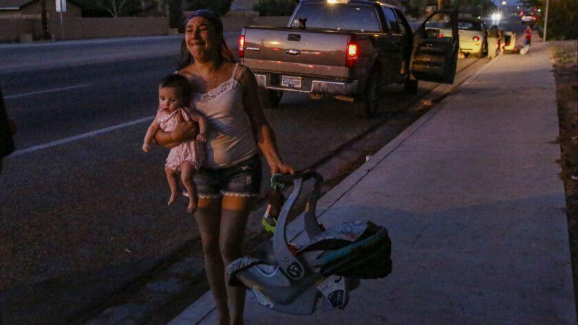 Dawn Inscore flees her Ridgecrest apartment after Friday night's magnitude 7.1 quake.