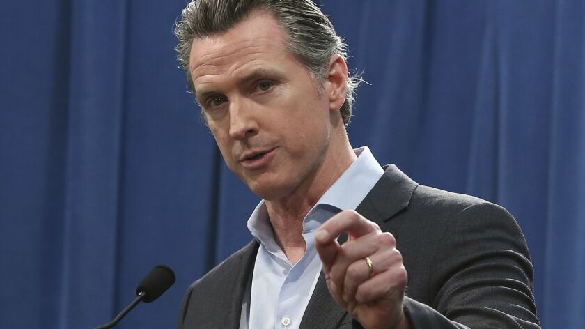 California Gov. Gavin Newsom talks to reporters at a Capitol news conference in Sacramento in February.