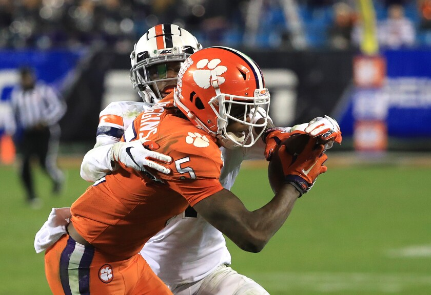 Clemson's Tee Higgins (5) makes a catch against Virginia's Nick Grant during the ACC championship game Dec. 7, 2019.