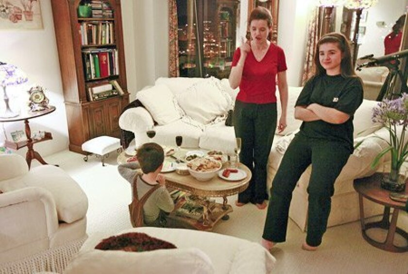 L'ubica Vargicová (center), who debuts with the San Diego Opera in 'Rigoletto,' made a point during a conversation at her downtown San Diego condo, home for a month for her and her husband, daughter Margareta, 13, and son Jakob, 6. (John R. McCutchen / Union-Tribune)