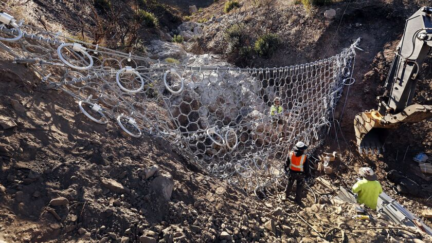 CAMARILLO, CA - DECEMBER 15, 2015 - Crews work on installation of one of five debris flow barriers e