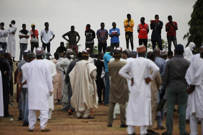 Mourners gather at a burial ground in Abuja, Nigeria, where presidential chief of staff Abba Kyari was buried April 18 after contracting the coronavirus.