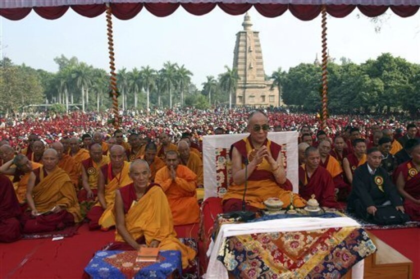 Tibetan spiritual leader the Dalai Lama offers special prayers for world peace along with others in Sarnath, about 18 kilometers (11 miles) from Varanasi, India, Tuesday, Jan. 13, 2009. (AP Photo/Rajesh Chaurasia)