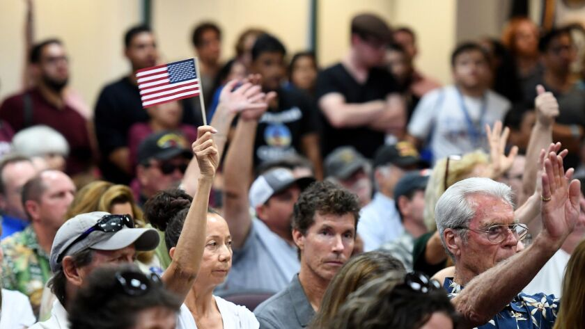 """SANTA CLARITA, CALIFORNIA MAY 8, 2018-Supporters against the """"sanctuary state"""" law raise there hands"""