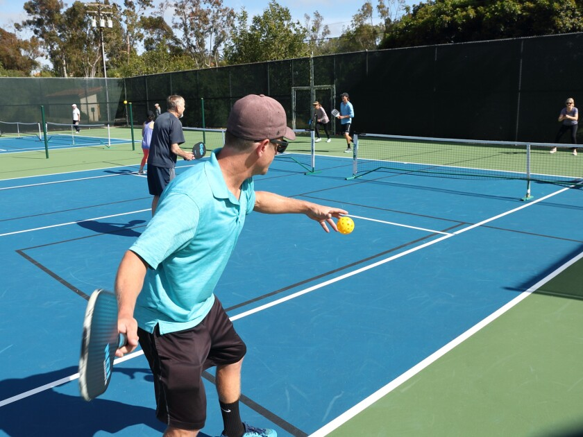 Blake Boswell serves in pickleball at the RSF Tennis Club.