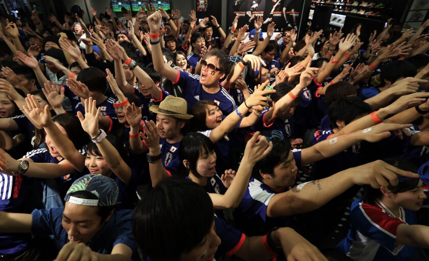 Japanese soccer fans, including these in Tokyo, had little to celebrate in losing to Ivory Coast in their World Cup opener on Saturday. But Japanese can be cheered by their country's high marks for economic competitiveness.