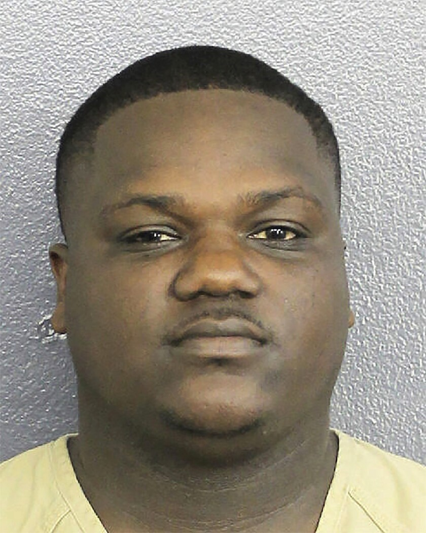 In this Jan. 4, 2020 photo made available by the Broward Sheriff's Office, Chauncy Devonte Lump is under arrest. Authorities charged Lump with threatening to kill President Trump in retaliation for the killing of Iranian Gen. Qassem Soleimani. (Broward County Sheriff's Office via AP)