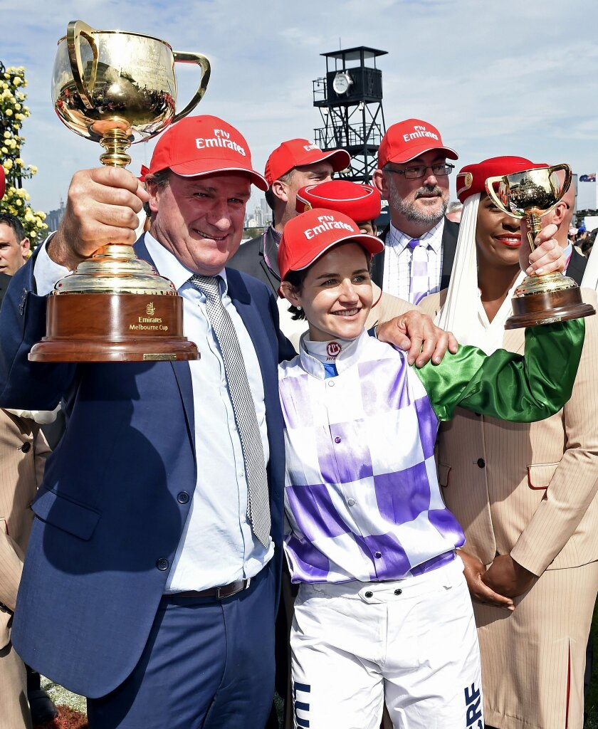 Prince of Penzance jockey Michelle Payne, right  with trainer Darren Weir, left, hold the winning trophies after the Melbourne Cup at Flemington Racecourse in Melbourne, Australia, Tuesday, Nov. 3, 2015. Michelle Payne became the first female jockey to win the Melbourne Cup on Tuesday when she rode