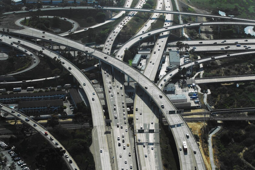 Traffic flows through the interchange of Interstates 5 and 8 in San Diego. The city's Climate Action Plan requires annual emissions be cut in half during the next two decades.