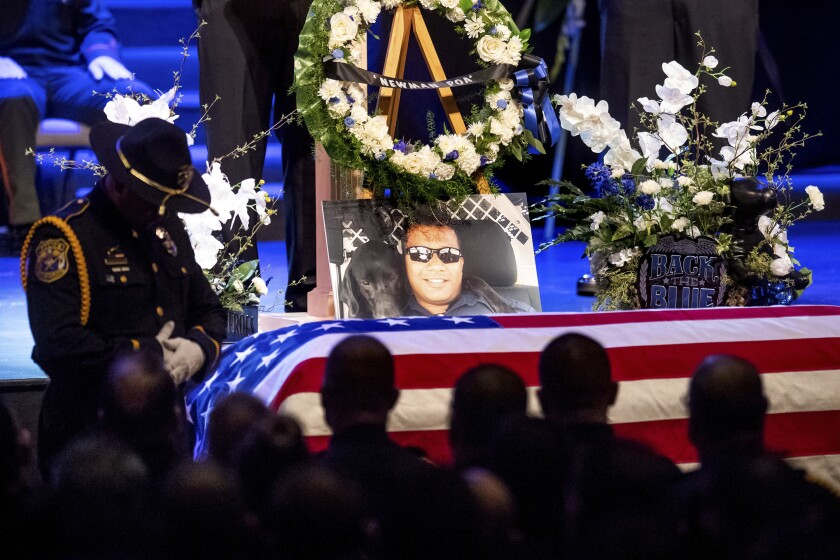 """A photo of slain Newman police Cpl. Ronil """"Ron"""" Singh rests atop his casket during his funeral on Jan. 5, 2019."""