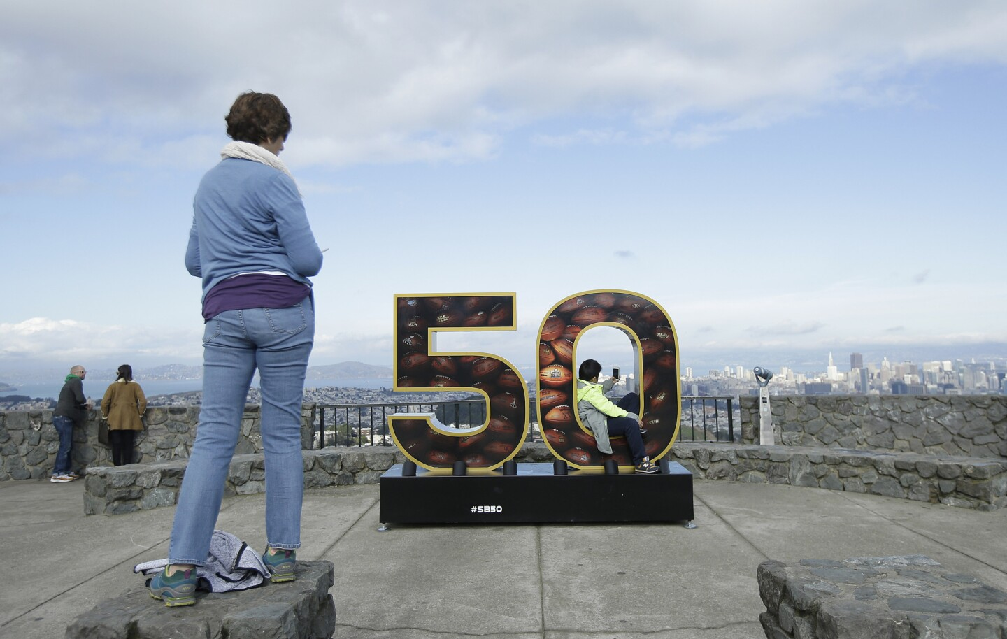 A Super Bowl 50 sign decorates a lookout point at Twin Peaks in San Francisco, Tuesday, Feb. 2, 2016. The Denver Broncos will play the Carolina Panthers in Super Bowl 50 Sunday, Feb. 7, 2016. (AP Photo/Jeff Chiu)