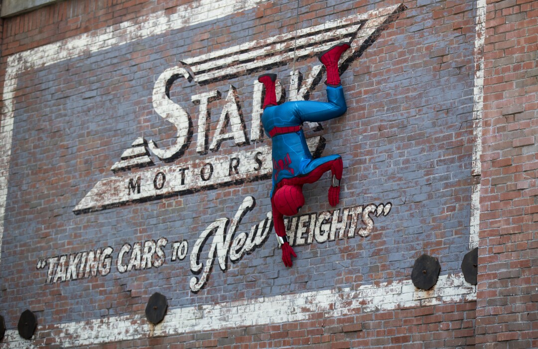 Spider-Man appears to crawl down the wall