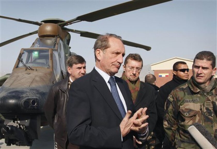 French Defense Minister Gerard Longuet speaks during a press conference after visiting French soldiers with the NATO- led International Security Assistance Force (ISAF) in Kabul, Afghanistan, Sunday, Jan. 1, 2012. France's defense minister on Sunday backed U.S. efforts to open peace talks with the Taliban, even as NATO reported the death of another service member that brought last year's toll to 544 troops killed in Afghanistan. (AP Photo/Musadeq Sadeq)