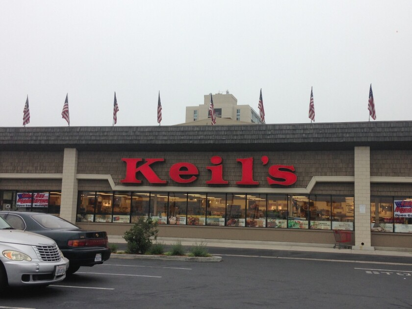 Top floors of Sorrento Tower are visible above Keil's market in Clairemont.