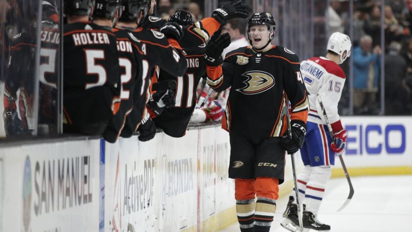 Ducks' Max Jones is congratulated by teammates after scoring a goal against the Montreal Canadiens during the third period on Friday at the Honda Center.