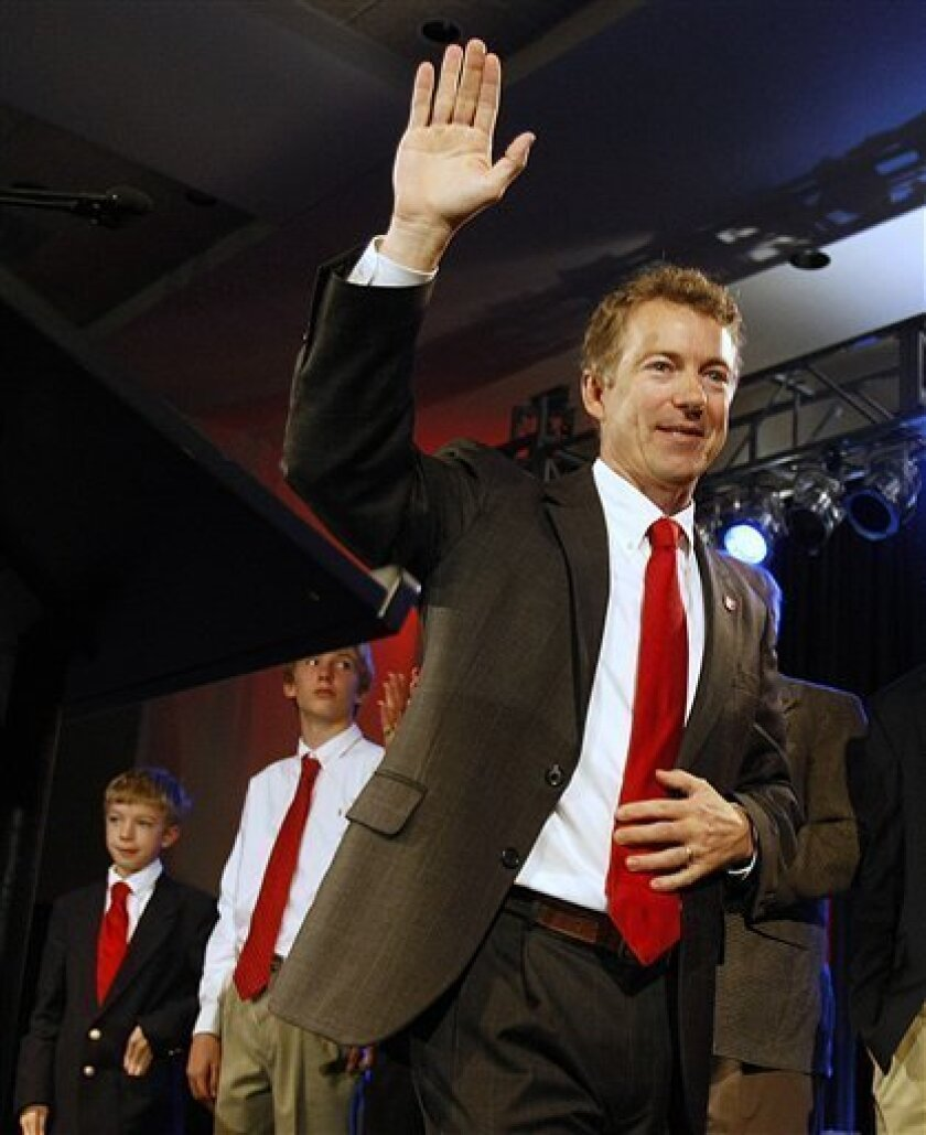 Republican Sen.-elect Rand Paul waves to supporters at his victory rally in Bowling Green, Ky., Tuesday, Nov. 2, 2010. (AP Photo/Ed Reinke)