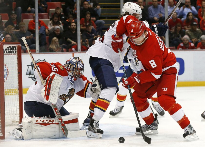 Florida Panthers goalie Al Montoya (35) stops a Detroit Red Wings left wing Justin Abdelkader (8) shot as Aaron Ekblad (5) defends in the second period of an NHL hockey game, Monday, Feb. 8, 2016 in Detroit. (AP Photo/Paul Sancya)