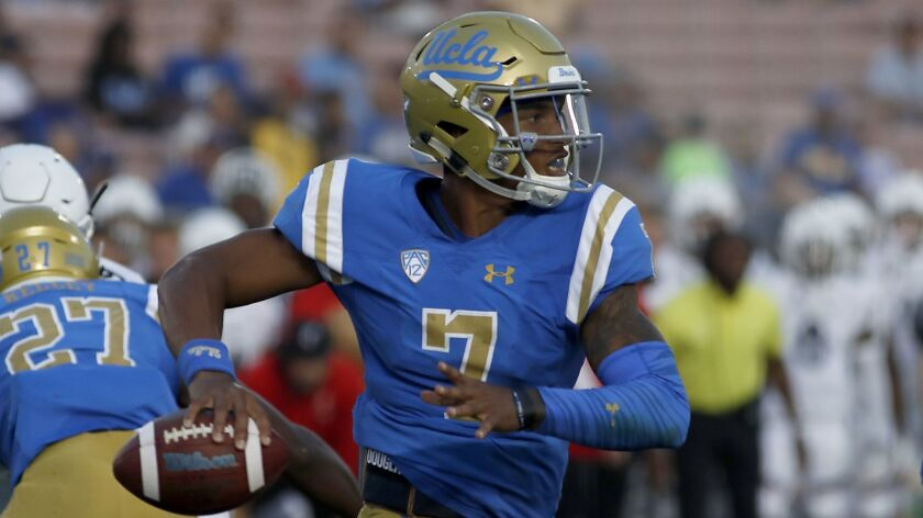 UCLA quarterback Dorian Thompson-Robinson looks to pass against Cincinnati on Sept. 1. Thompson-Robinson worked with the first-team offense on the opening day of spring practice Tuesday.