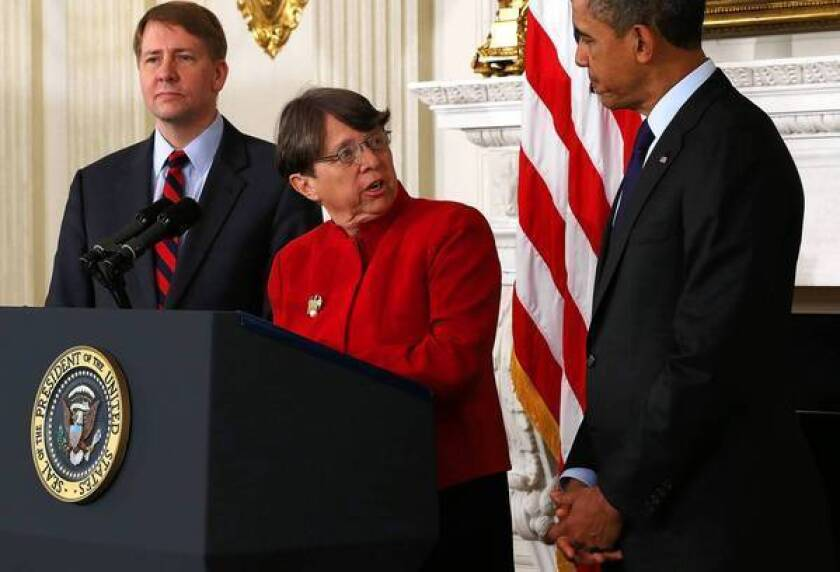 Mary Jo White, a former U.S. attorney in Manhattan known for high-profile prosecutions of mobsters and terrorists who is now President Obama's nominee to lead the SEC, speaks as Obama and Consumer Financial Protection Bureau chief Richard Cordray look on during a personnel announcement at the White House last month.