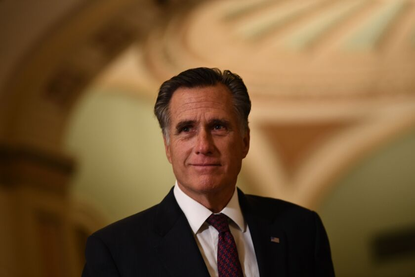 Sen. Mitt Romney during a recess in the impeachment trial against President Trump.