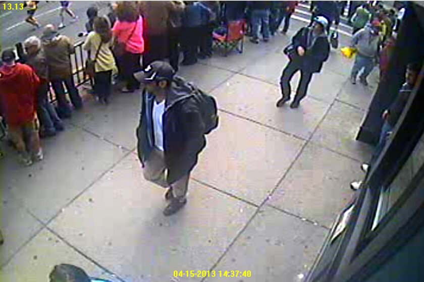 A photo released by the FBI shows two men suspected in the Boston Marathon bombings that killed three people and injured about 180.